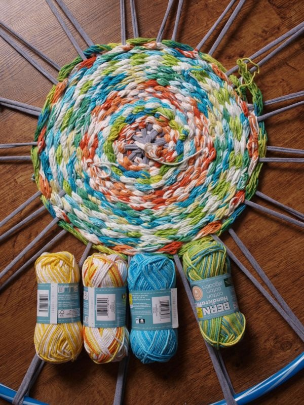Thinking of this to use up all my extra yarn! By Hook & Thread: Finger Knitting Woven Rug