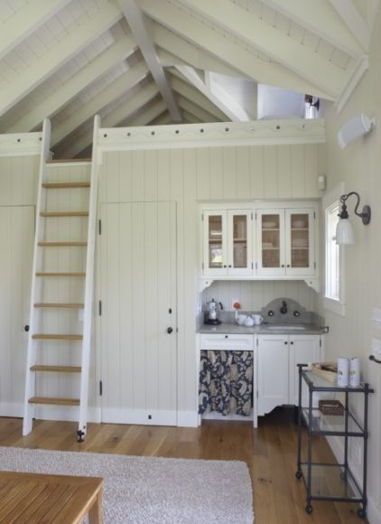 This cottage makes excellent use of space with a loft reached by a ladder and with built-in cupboards, a sink and closets below. small-homes