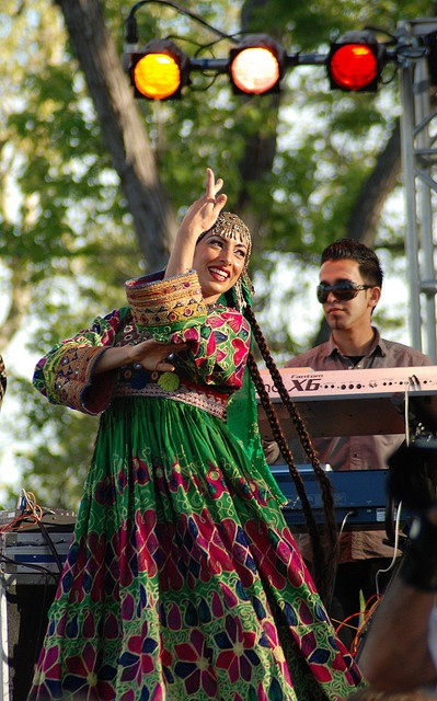 Afghan girl dancing to traditional Afghan Music