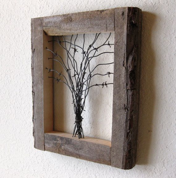 Reclaimed Barn Wood and Barbed Wire Tree Wall Art. This is about the ONLY thing barbed wire is good for. I could totally do this too.. we have the wood and way too much crap barbed wire that I can't wait to make disappear.