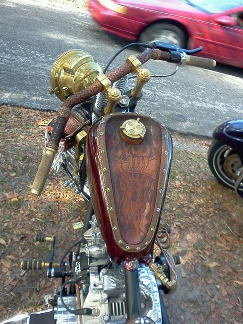 Brass ships spotlight for a headlight,engraved rocker boxes and that tank. Love the details ...