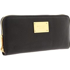 Michael Kors - Zip around wallet in either black or royal blue