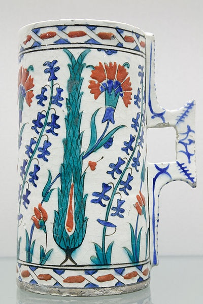 Tankard with cypresses and flowers.circa 1560.stone-paste; transparent glaze on painted decoration