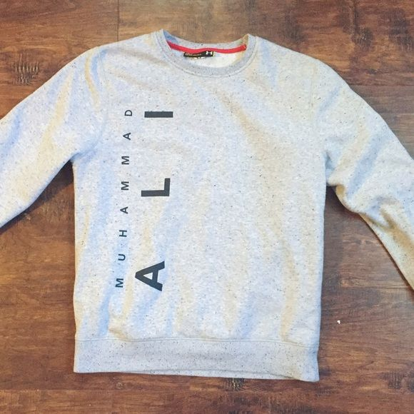 Under Armor Crewneck MOVING SALE! Under Amor 'Muhammad Ali' Crewneck. Men's size small, can fit a women's small/medium. New without tags. Gray with speckles on it. TAKING ALL REASONABLE OFFERS NOW! Under Armour Sweaters Crew & Scoop Necks