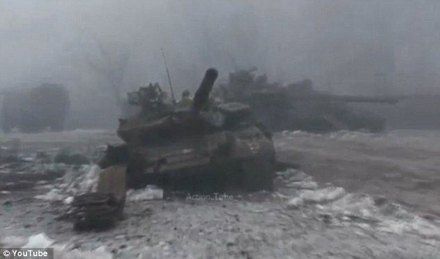 Two Russian tanks sit damaged following the battle with Ukrainian forces...