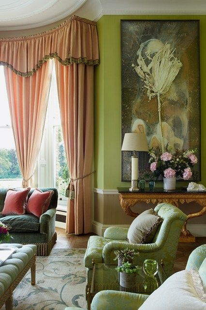 In the drawing room of this Hampshire country house, curtains in 'Strie' from George Spncer Design frame the bay windows.