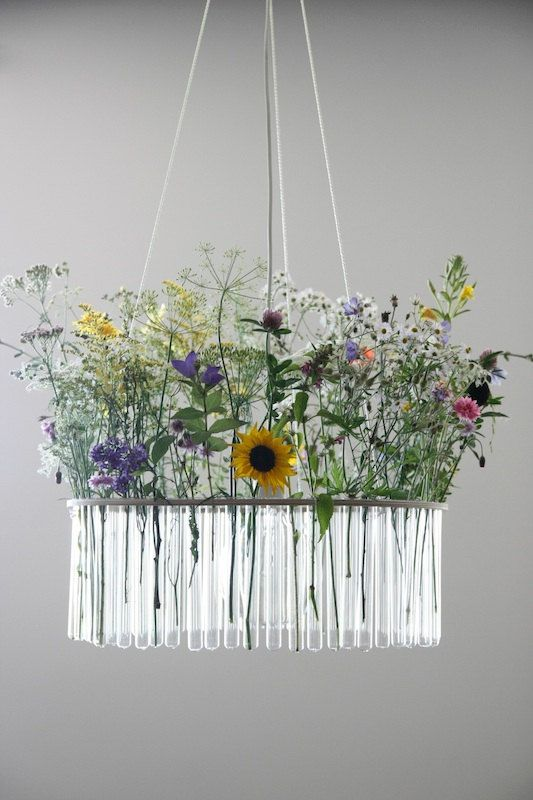 "I have to admit I never really got the whole ""test tube chandelier"" thing. I thought it was weird and arbitrary. Until I saw this! Fill those test tubes with flowers? That's actually really cute!"