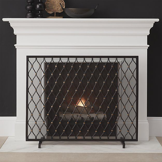 Our beautiful fireplace screen patterns the hearth with a sophisticated trellis motif. Handcrafted in India, the screen is made of iron with brass detailing.