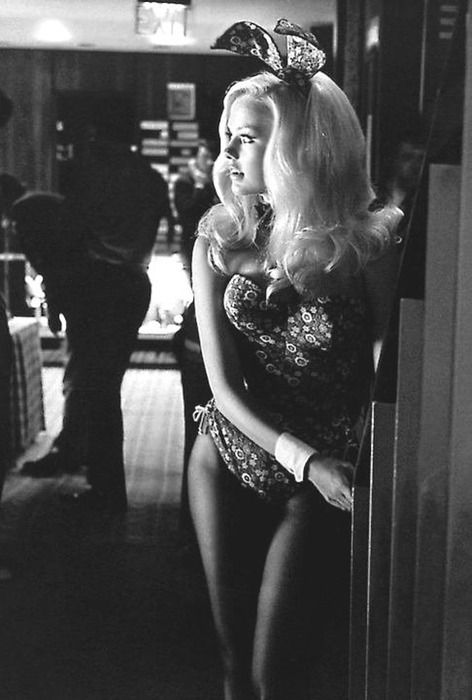 Beautiful image of a Playboy Bunny, I love that her ensemble is of a printed fabric.