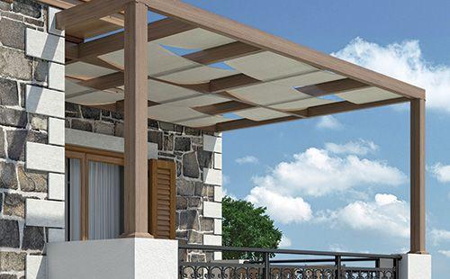 Πέργκολες. Μοντέρνα με τη χρήση πανιού. Ο συνδυασμός της μοντέρνας πέργκολας με πανί προσφέρει επιπλέον σκίαση σε πολλές εφαρμογές όπως σε μπαλκόνια, κήπους κ.ά. Pergolas System. Modern with canvas roofing. The combination of modern pergolas with canvas offer additional shading to balconies, gardens etc.