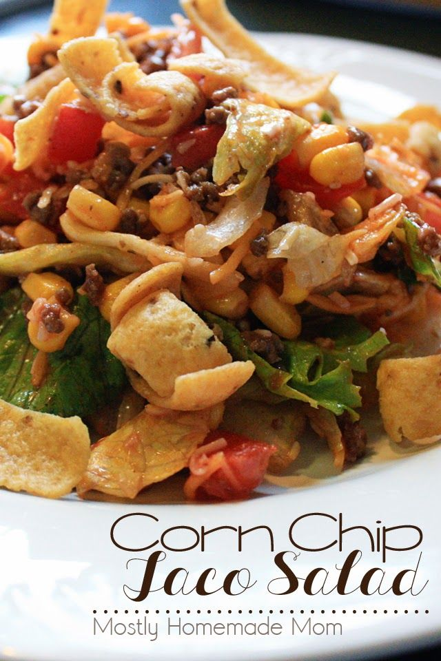 Corn Chip Taco Salad - taco meat, corn, black beans, tomatoes, cheese, and corn chips over lettuce blend and topped with dressing. One of my family's favorite weeknight meals!
