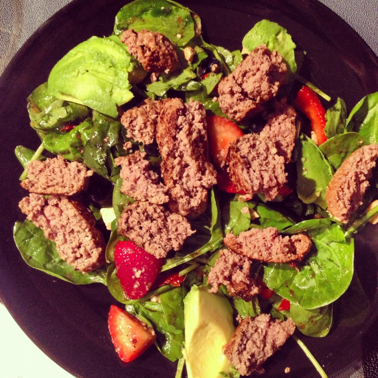 Delicious salad... Spinach, venison, strawberries, blueberries, sun dried tomatoes, avocado, feta and balsamic vinaigrette.