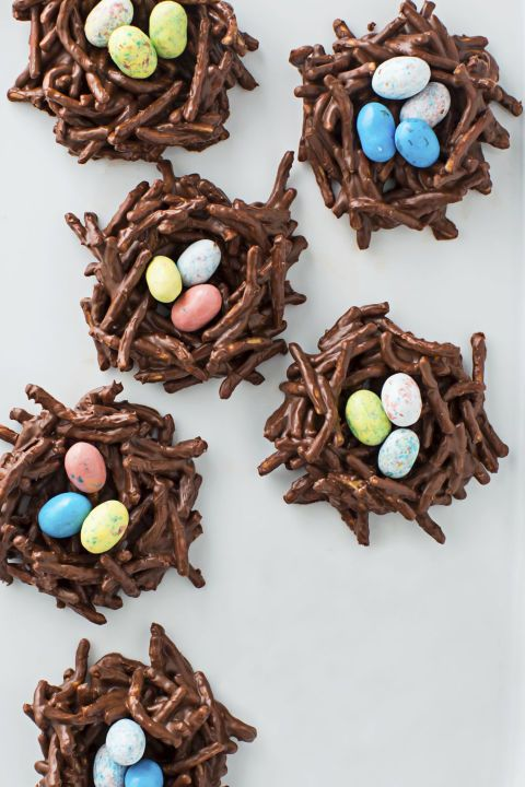 Chocolate Nests-The secret ingredient in these chocolate egg nests? Chow mein noodles. See more perfect Easter treats at GoodHousekeeping.com.