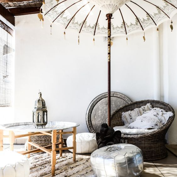 Love this outdoor bohemian set up. This Boho umbrella is AMAZING.