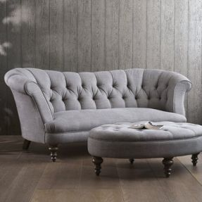 an amazing settee covered in pillows with a large round ottoman would make her room feel