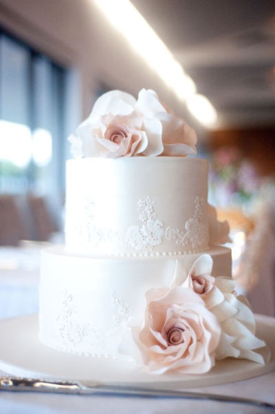 Maybe a small cake like this with some fancy, decorated cupcakes :)