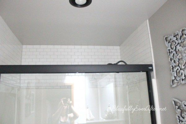 decorating and update ideas for fibreglass shower or tub surround using white subway tile above the shower wall corner shower or tub