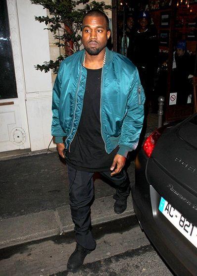 Kanye West wearing a bright blue bomber jacket
