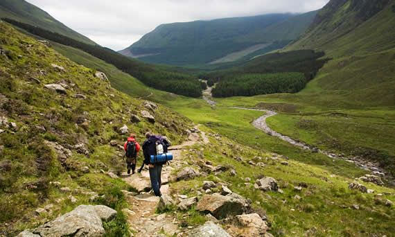 Walkers making their way along Jock's Road, an old drove route leading over the hills from Braemar to Glen Clova