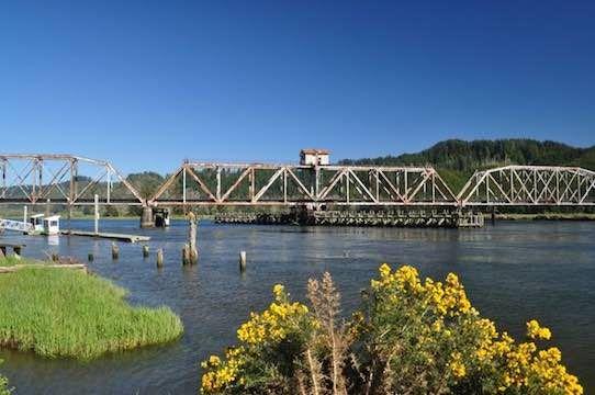 Siuslaw River Bridge No. 7 (Coos Bay Rail Link) at Cushman, Oregon – built in 1914 as a swing span bridge to allow passage of ocean-going lumber barges.