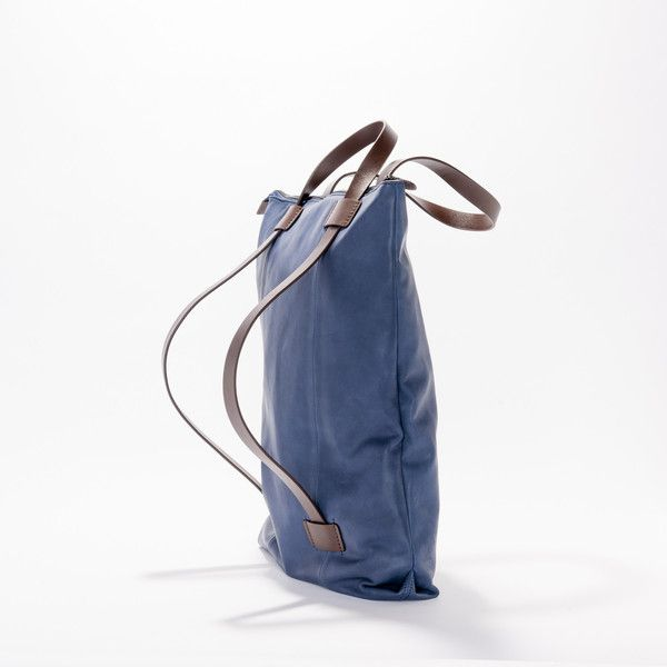 A versatile, Limited Edition full leather handbag that can be worn over the shoulder or as a backpack. Perfect for everyday use and lined with 100% cotton.