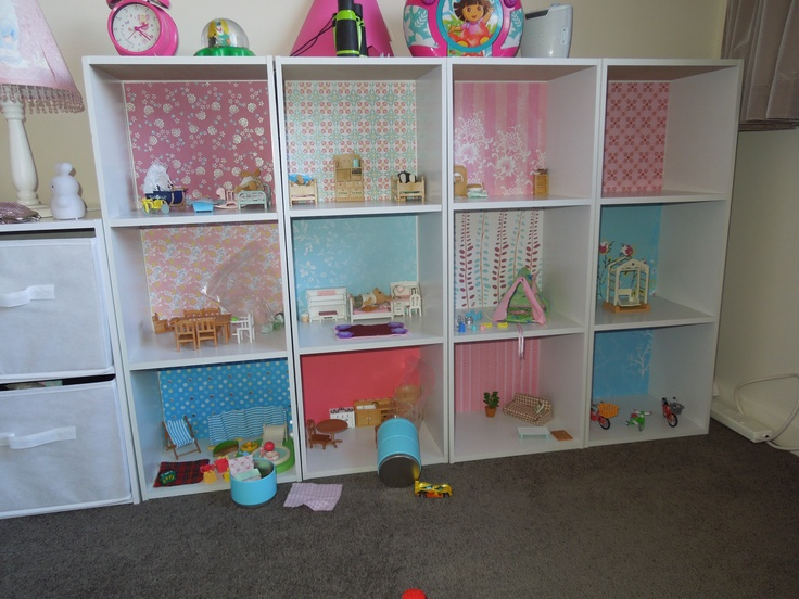 "Our new Sylvanian Families house - cheap bookshelves with scrapbooking paper as ""feature"" wallpaper."