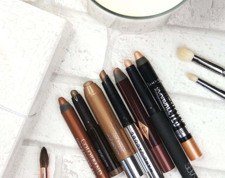 Best cream eyeshadow sticks from affordable and high-end brands including NARS, Rimmel, Clinique, Charlotte Tilbury, Marc Jacobs, Laura Mercier & Bourjois. Includes swatches.