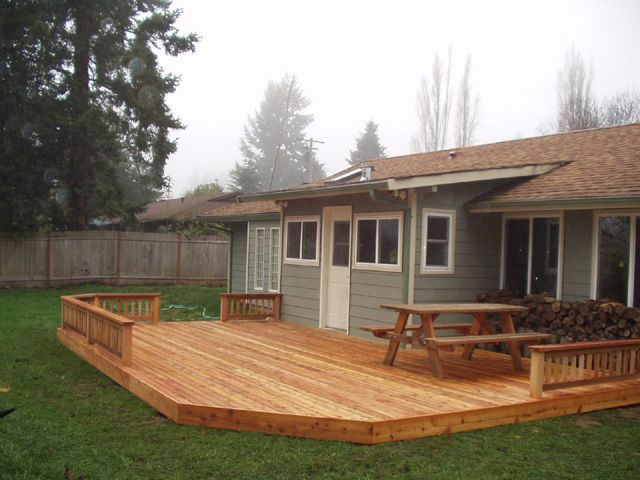 Simple backyard deck this might work for our yard for Backyard deck pictures