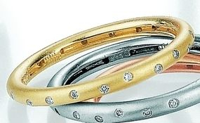 18 Carat Yellow Gold and Diamond Stacking Ring. #unusual #wedding #rings #London #Nude #Jewellery