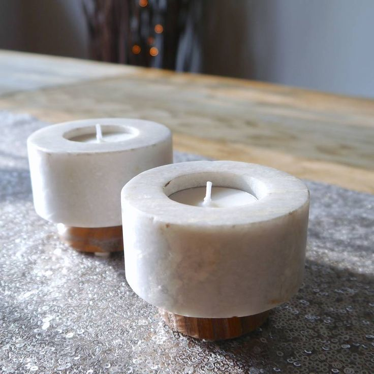 A very stylish and design-led contemporary wood and stone tealight holder. Reassuringly heavy and solid. Scandi Chic at its finest.