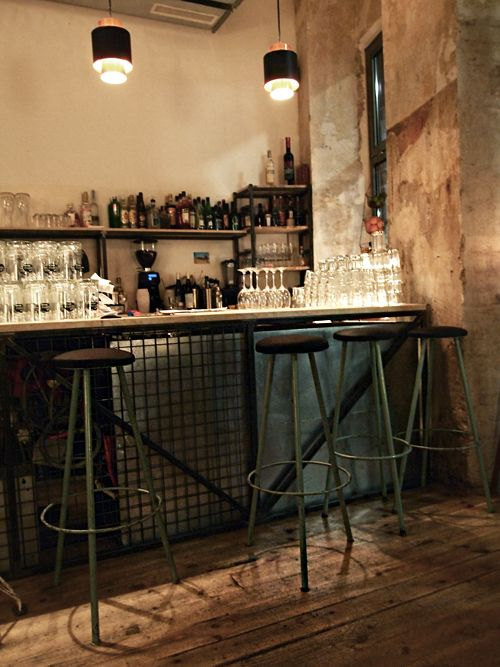 leibling bar | vienna - Love the wood floor and wall. Not to mention the bar looks pretty cool as well. Don't think I would use stools that high though.