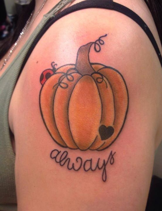 Cute pumpkin with ladybug tattoo by Amber Amadon