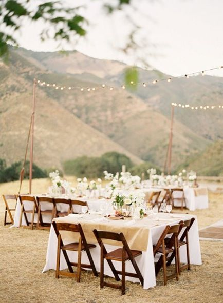 string lights, outdoor wedding reception, wood chairs