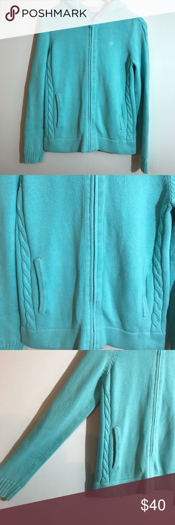 "Lilly Pulitzer Blue Zip Up Hooded Sweater Medium Gently used condition. Super soft and cozy. Full zipper, 2 front pockets and a hood. Size medium. Measurements taken laid flat and zipped: bust approximately 19"", length approximately 24"". Check out my closet for the same sweater in pink! Lilly Pulitzer Sweaters Cardigans"