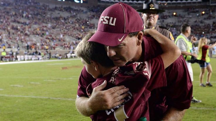 FSU head football coach gets a hug from his son, Ethan, who suffers with a rare blood disease called Fanconi anemia.