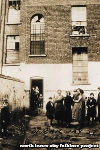 1930s.. Back yard of a tenement houses at 37 Railway Street Dublin. (In the Monto)
