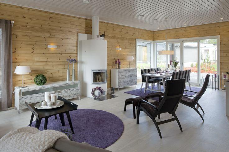 Honka Kaarna. Honka log homes. Fireplace Aino by Linnatuli Oy.