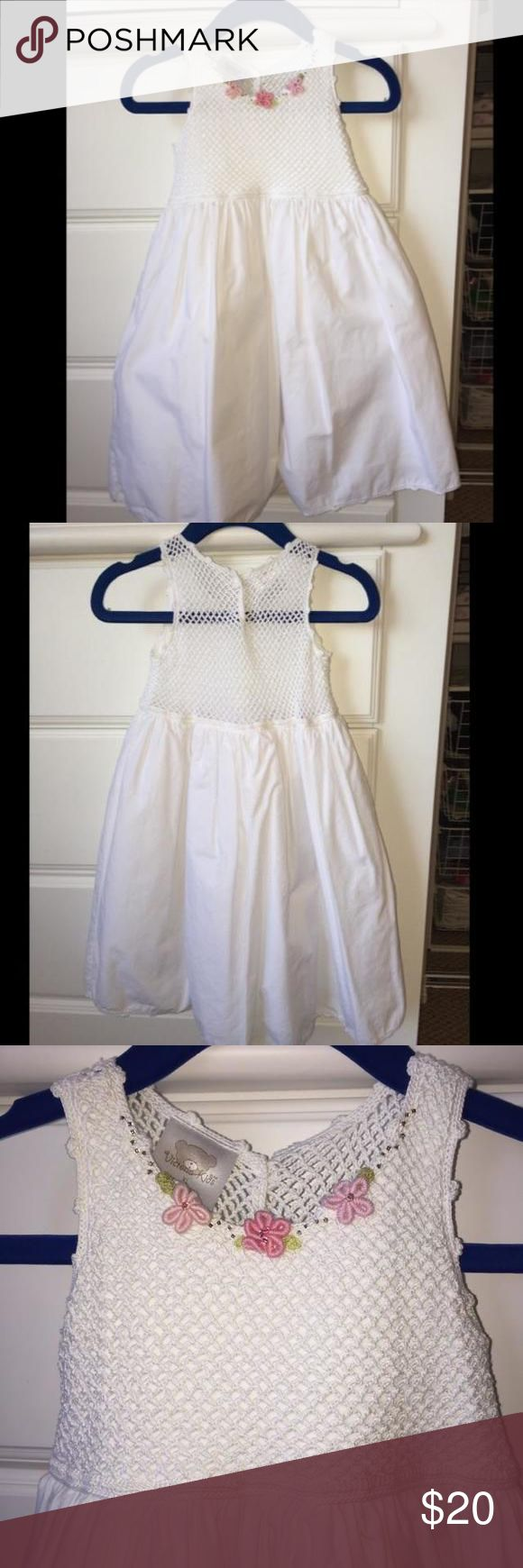 Victoria Kids White Dress Gorgeous white Victoria Kids Dress. Retails at over $70! Like new, worn once, no signs of wear. Tag says 18-24 mos but fit my tall, slim 2 year old perfectly. Fully lined. Comes with matching cropped cardigan. Victoria Kids Dresses
