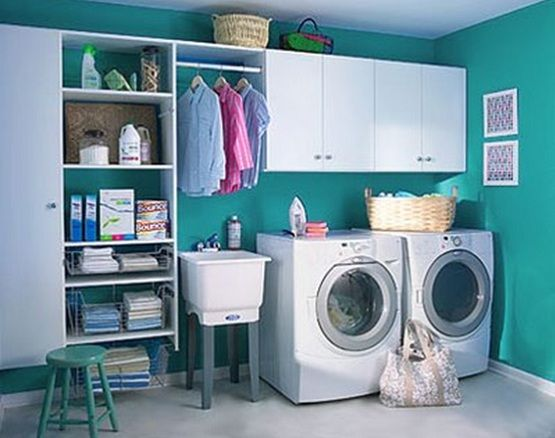 White blue small laundry room design Comfortable Small Laundry Room Design. Love the tension rod to hang clothes.
