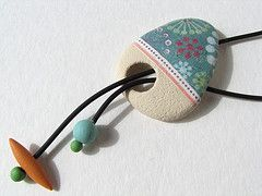 Polymer Clay. Okay, change the shape and colors, add buttons or other beads at the ends and use ribbon instead of leather cord.