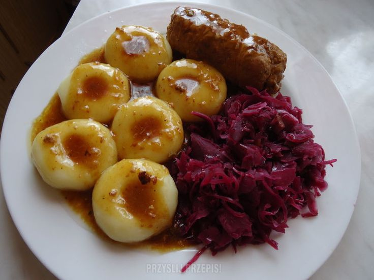 Rolada z modrą kapustą (rouladen with red cabbage) - best-quality beef-meat roll; stuffed with pickled vegetable, ham, and good amount of seasoning; always served with red cabbage (with fried bacon, fresh onion and allspice); traditionally eaten with kluski śląskie for Sunday dinner.
