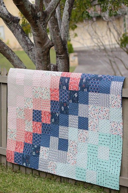 A simple square patchwork baby quilt. Here's a quilt tutorial to sew this quick easy baby quilt, that packs a punch with fabric placement.