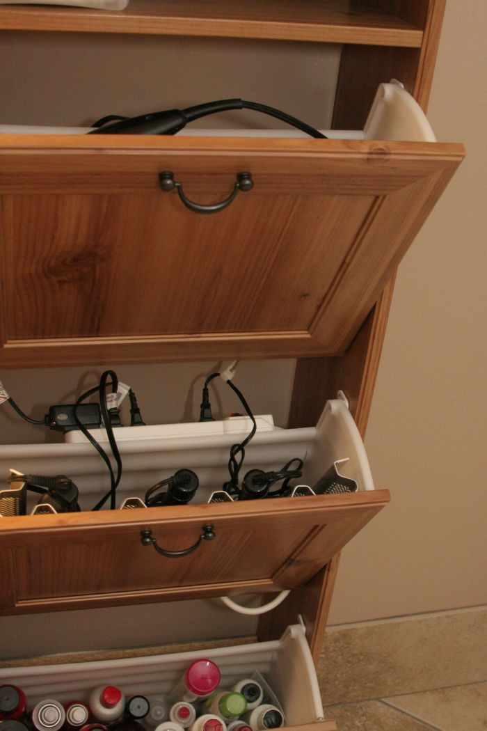 Ikea shoe rack used as a bathroom station for hair dryer/straighter and storage. Genius, I HAVE to remember this!