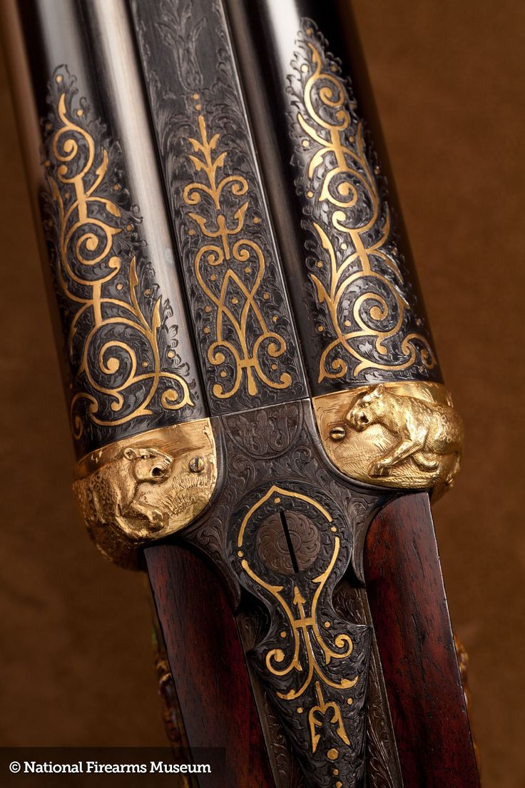 A Holland & Holland double rifle in .500/.465 Nitro Express, this unusual piece has cloisonné enamel and attached gold plates highlighting and embellishing engraving details. The alligator casing is marked to Paigah ruler, Muhammed Moinuddin Khan, Nawab Moin-ud-Doula Bahadur and Amir of Hyderabad and was likely displayed at Bashir Bagh Palace.  A classic Maharaja grade piece from the 1920's.
