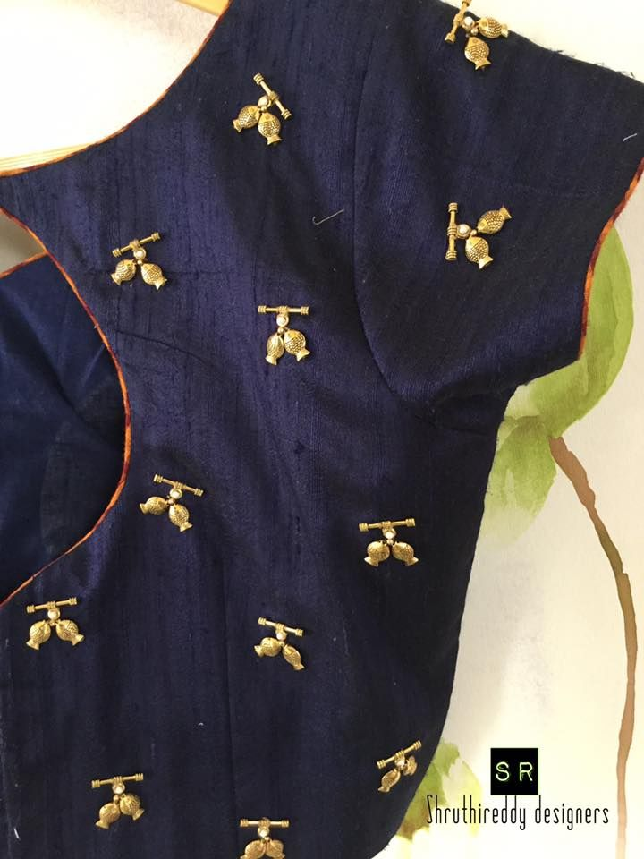 Lovely little fish blouse. Beautiful blue color designer blouse with pair of fish design hand embroidery gold thread work. 25 January 2018