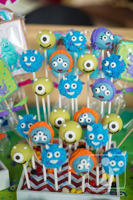 San Diego, CA family photographers. Sweet Monsters Inc birthday party for little girl at Kid Ventures in Eastlake! Monsters Inc Mike an Sully cake pops, cookies and a big Sully cake!