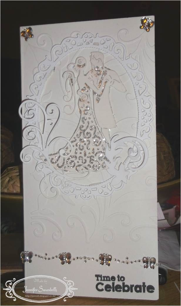 I used the Spellbinders Opulent Ovals and put the Tattered Lace Wedding Couple in the centre. I embossed the card with an unknown embossing folder (sorry about this). Behind the couple, I put a silver shimmer card (although in parts it looks like gold, although I tried to remove this), I used some flourishes at the side of the wedding couple and used a silvery butterfly embellishment along the bottom of the card and two silvery butterflies at the top of the card.