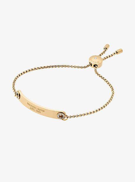 79fad264d92f Michael Kors Pave Gold-Tone Logo Plaque Slider Bracelet Sparkling Pave  Crystals Punctuate This Polished Slider Bracelet With Understated G…