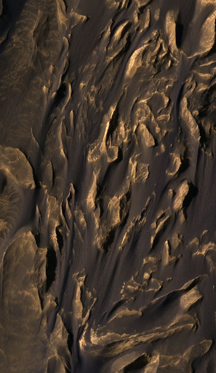 A piece of Mars: Wind ha blown the dark, rippled sand between jagged hills, from top to bottom in this frame (663 m or 2175 ft across). Regardless of the terrain, sand finds a way to get through -- just like at the beach, it manages to get everywhere. (HiRISE ESP_037494_1685, NASA/JPL/Univ. of Arizona)