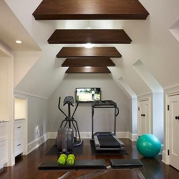 Attic Home Gym with Wood Ceiling Beams